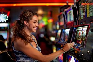 girl plays slot machines